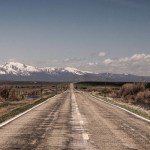 open road to the far mountains, photo by Ryan McGuire